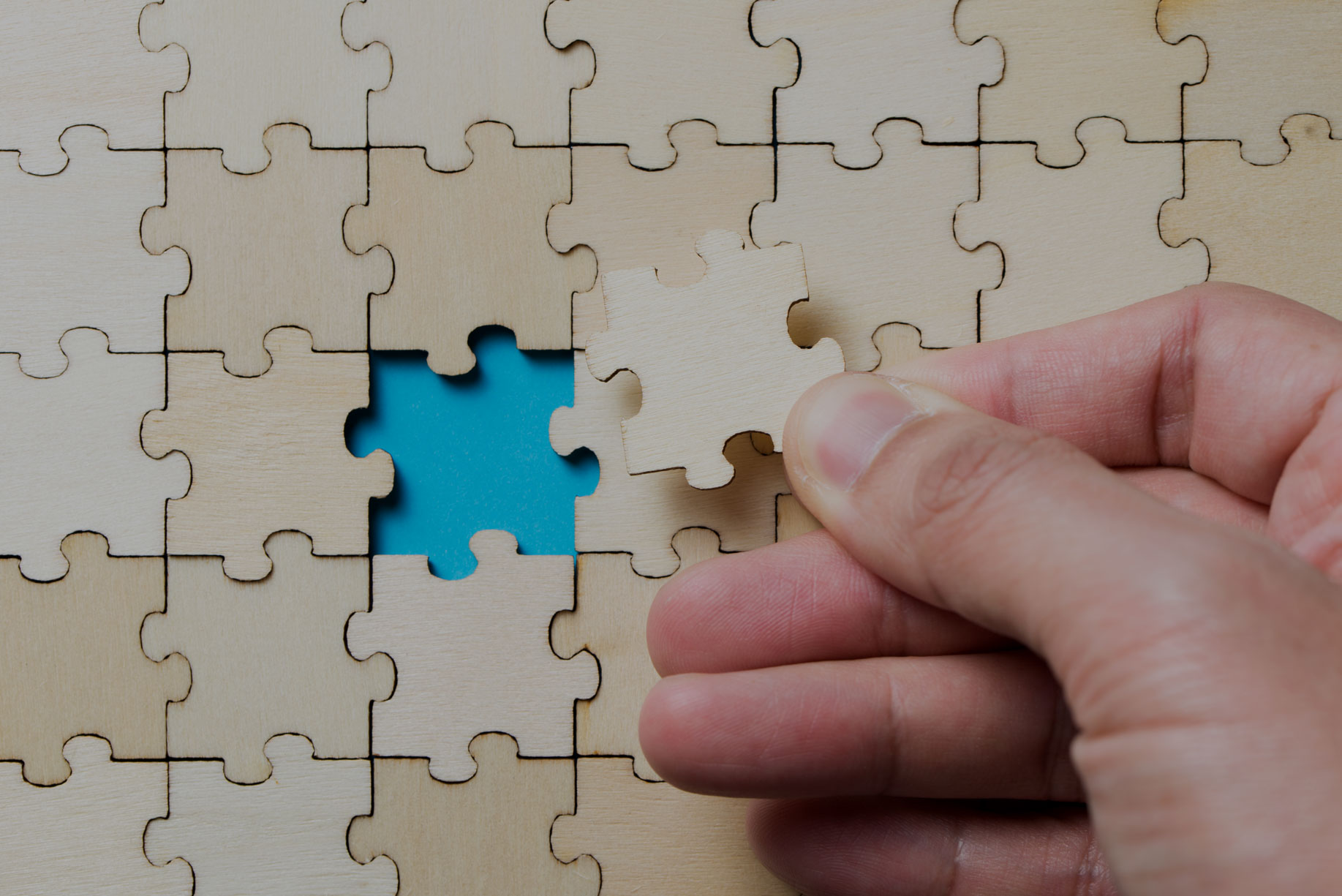 the-last-piece-of-a-jigsaw-wooden-puzzle-PTS8ZRC